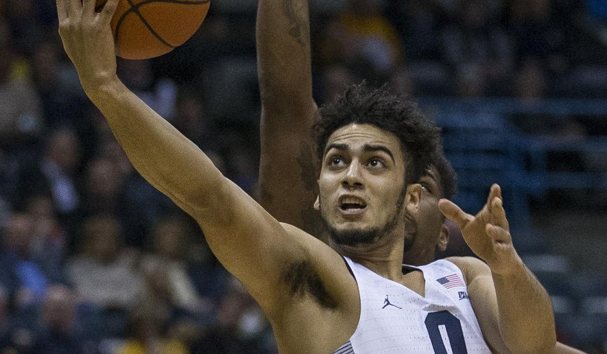 Marquette's Markus Howard puts up a lay-up against Seton Hall during the first half of an NCAA college basketball game Wednesday, Jan. 11, 2017, in Milwaukee. (AP Photo/Tom Lynn)