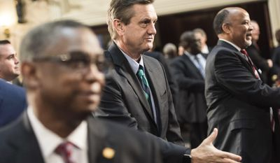 Sen. Tom Davis, R-Beaufort, greets fellow lawmakers before the state of the state address in the House chambers at the state Capitol, Wednesday, Jan. 11, 2017, in Columbia, S.C. (AP Photo/Sean Rayford)