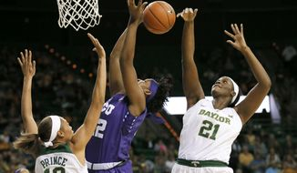 Baylor's Alexis Prince (12) helps defend as center Kalani Brown (21) blocks a shot attempt by TCU's Jordan Moore (22) in the first half of an NCAA college basketball game, Wednesday, Jan. 11, 2017, in Waco, Texas. (AP Photo/Tony Gutierrez)