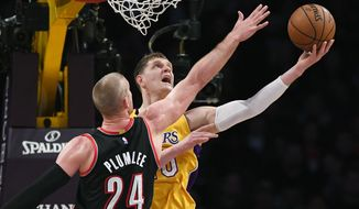 Los Angeles Lakers center Timofey Mozgov, right, of Russia, shoots as Portland Trail Blazers center Mason Plumlee defends during the first half of an NBA basketball game, Tuesday, Jan. 10, 2017, in Los Angeles. (AP Photo/Mark J. Terrill)