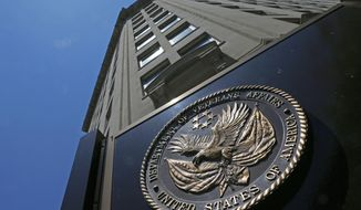 "FILE - In this June 21, 2013, file photo, the seal a fixed to the front of the Department of Veterans Affairs building in Washington. Veterans health care remains a ""high risk"" issue threatening the federal budget and quality of care for former service members, auditors say in a forthcoming report. (AP Photo/Charles Dharapak, File)"