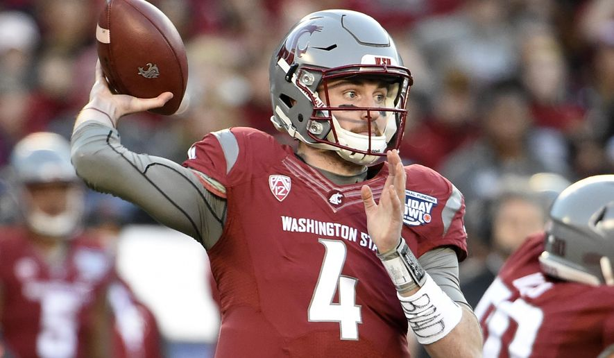 FILE - In this Dec. 27, 2016, file photo, Washington State quarterback Luke Falk (4) passes during the first half of the Holiday Bowl NCAA college football game against Minnesota, in San Diego. Falk says he will return for his senior season. Falk made the announcement Wednesday morning, Jan. 11, 2017. (AP Photo/Denis Poroy, File)