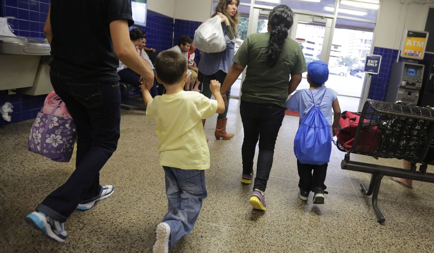 FILE - In this July 7, 2015, file photo, immigrants from El Salvador who entered the country illegally walk through a bus after they were released from a family detention center in San Antonio. Central Americans attempting to enter the United States illegally on the country's border with Mexico helped drive a 15 percent increase in immigration arrests during the 2016 fiscal year, according to U.S. Department of Homeland Security figures released Friday, Dec. 30. 2016. (AP Photo/Eric Gay, File)