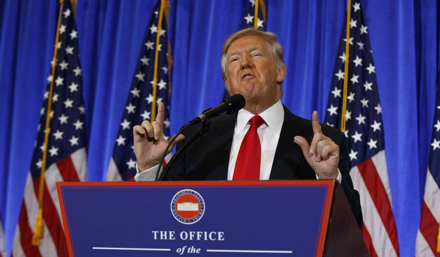 In this Jan. 11, 2017, photo, President-elect Donald Trump speaks during a news conference in the lobby of Trump Tower in New York. The outgoing president somberly ruminated about the fragility of democracy and earnestly implored Americans to reject corrosive political dialogue. Fourteen hours later, the incoming president staged a defiant and frenetic news conference at his gilded New York City tower, dismissing critics, insulting reporters and likening the country's intelligence officers to Nazis. (AP Photo/Evan Vucci)
