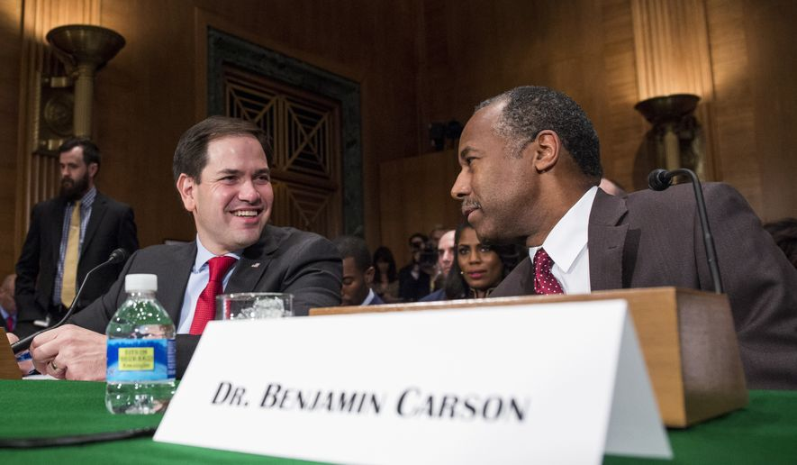 Housing and Urban Development Secretary-designate Ben Carson speaks to Sen. Marco Rubio, R-Fla. on Capitol Hill in Washington, Thursday, Jan. 12, 2017, prior to the start of Carson's confirmation hearing before the Senate Banking, Housing, and Urban Affairs Committee.  (AP Photo/Zach Gibson)