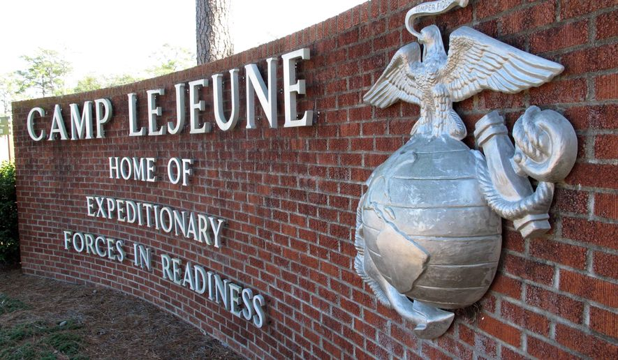 In this March 19, 2013, file photo, the globe and anchor stand at the entrance to Camp Lejeune, N.C. (AP Photo/Allen Breed, File)