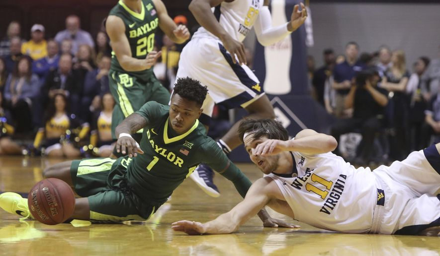 Baylor guard Wendell Mitchell (1) and West Virginia forward Nathan Adrian (11) dive for a loose ball during the first half of an NCAA college basketball game, Tuesday, Jan. 10, 2017, in Morgantown, W.Va. (AP Photo/Raymond Thompson)
