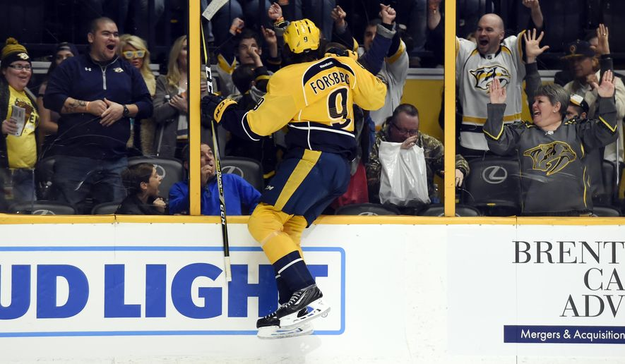 Nashville Predators left wing Filip Forsberg (9), of Sweden, leaps into the glass as he celebrates his goal against the Boston Bruins during the second period of an NHL hockey game Thursday, Jan. 12, 2017, in Nashville, Tenn. (AP Photo/Mark Zaleski)