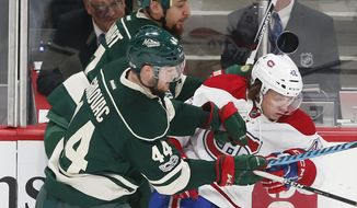 Minnesota Wild's Tyler Graovac, left, ties up Montreal Canadiens' Sven Andrighetto of Switzerland along the boards during the first period of an NHL hockey game Thursday, Jan. 12, 2017, in St. Paul, Minn. (AP Photo/Jim Mone) **FILE**