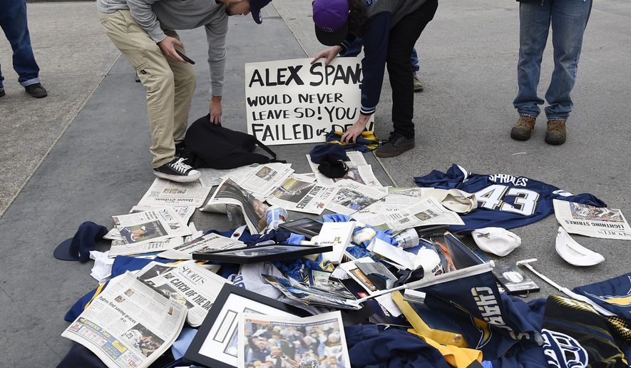 Former Chargers fans dump memorabilia in front of Chargers headquarters after the team announced that it will move to Los Angeles, Thursday Jan. 12, 2017, in San Diego. (AP Photo/Denis Poroy)