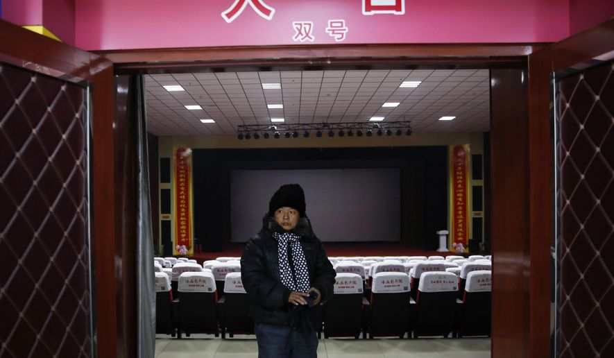 In this Dec. 12, 2016 photo, a man walks out from a main screening hall of the Digital Cinema in Zhuolu county in north China's Hebei province. The brightly-decorated 3-D cinema in this town outside Beijing is showing the latest Chinese and Hollywood films, to row after row of empty red seats. So few people come to watch films here that the theater manager rents out the halls to travelling sales companies or music teachers. (AP Photo/Andy Wong)