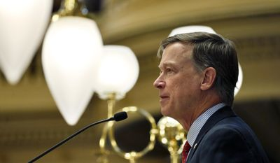 Colorado Gov. John Hickenlooper delivers his annual State of the State address to lawmakers and guests, inside the state legislature, in Denver, Thursday, Jan. 12, 2017. Hickenlooper set his priorities on roads and housing, health care and pot regulation when he addressed the just-convened 2017 Legislature. (AP Photo/Brennan Linsley)