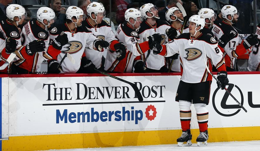 Anaheim Ducks center Rickard Rakell celebrates a goal with teammates on the bench during the first period of an NHL hockey game against the Colorado Avalanche Thursday, Jan. 12, 2017, in Denver. (AP Photo/Jack Dempsey)