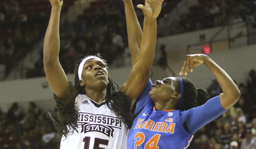 Mississippi State center Teaira McCowan (15) shoots a hook shot around Florida center Tyshara Fleming (24) during the first half of an NCAA college basketball game in Starkville, Miss., Thursday, Jan. 12, 2017. (AP Photo/Jim Lytle)