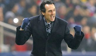 FILE- In this Saturday, Jan. 7, 2017 file photo, PSG's coach Unai Emery gestures during the French Cup soccer match Paris Saint-Germain against Bastia at Parc des Princes stadium in Paris. The statistics look good for Paris Saint-Germain, but those wins were against poor sides and PSG faces a stiffer test this weekend when it travels to play Rennes as the French league resumes. (AP Photo/Michel Euler, File)