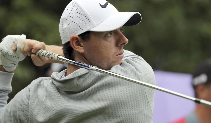 FILE - In this Thursday, Oct. 27, 2016 file photo, Rory McIlroy of Northern Ireland hits a tee shot during the WGC-HSBC Champions golf tournament at the Sheshan International Golf Club in Shanghai, China. Rory McIlroy made an impressive start to 2017 with a new set of clubs, shooting a 5-under 67 in the first round at the SA Open on Thursday, Jan. 12, 2017. Making his first appearance at the tournament since 2008, McIlroy rolled in seven birdies - including four straight from Nos. 14-17 after starting at the 10th - to lie a shot off the lead held by Trevor Fisher Jr. after the morning starters. (AP Photo/Ng Han Guan, file)