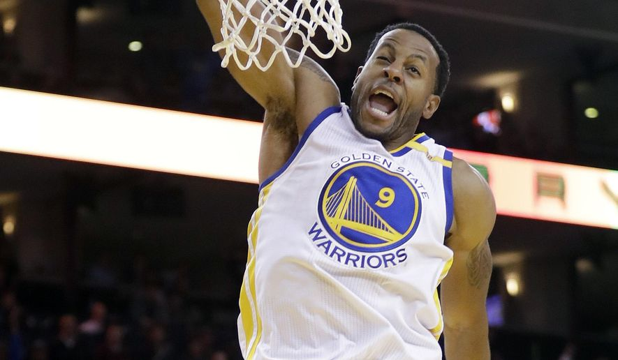 Golden State Warriors' Andre Iguodala (9) dunks against the Miami Heat during the second half of an NBA basketball game Tuesday, Jan. 10, 2017, in Oakland, Calif. Golden State won 107-95. (AP Photo/Marcio Jose Sanchez)