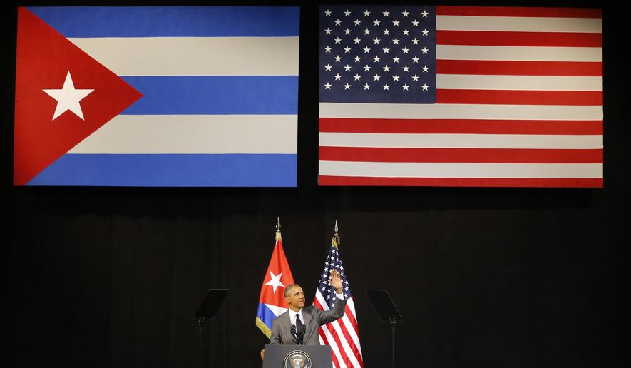FILE - In this March 22, 2016 file photo, President Barack Obama speaks at the Grand Theater of Havana, Cuba. President Barack Obama is ending a longstanding immigration policy that allows any Cuban national who makes it to U.S. soil to stay and become a legal resident, a senior administration official said Thursday, Jan. 12, 2017.  (AP Photo/Desmond Boylan, File)