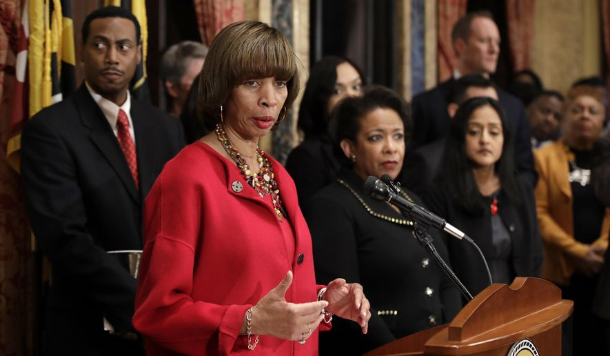 Baltimore Mayor Catherine Pugh speaks during a joint news conference in Baltimore, Thursday, Jan. 12, 2017, to announce the Baltimore Police Department's commitment to a sweeping overhaul of its practices under a court-enforceable agreement with the federal government. Standing behind Pugh is Attorney General Loretta Lynch, center right. (AP Photo/Patrick Semansky)