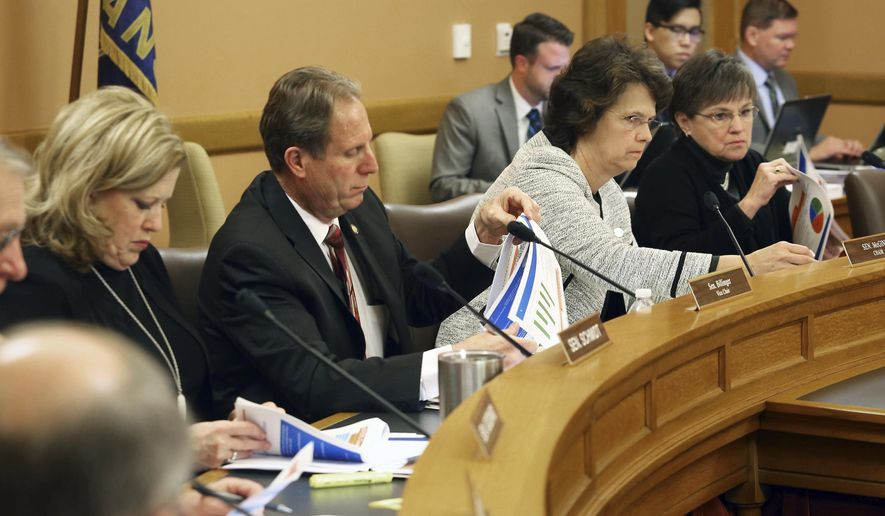 Members of the Senate Ways and Means Committee listen as Kansas Public Employees Retirement System Executive Director Alan Conroy, gave them a KPERS update and overview Thursday, Jan, 12, 2017, at the Capitol in Topeka. (Thad Allton/Topeka Capital-Journal via AP)