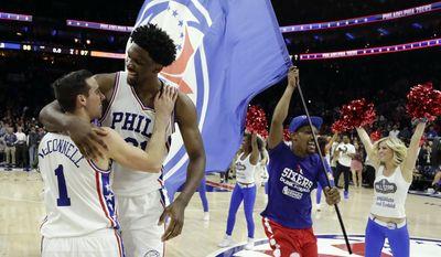 Philadelphia 76ers' Joel Embiid, right, and Philadelphia 76ers' T.J. McConnell celebrate after McDonnell's game-winning basket during an NBA basketball game against the New York Knicks, Wednesday, Jan. 11, 2017, in Philadelphia. Philadelphia won 98-97. (AP Photo/Matt Slocum)