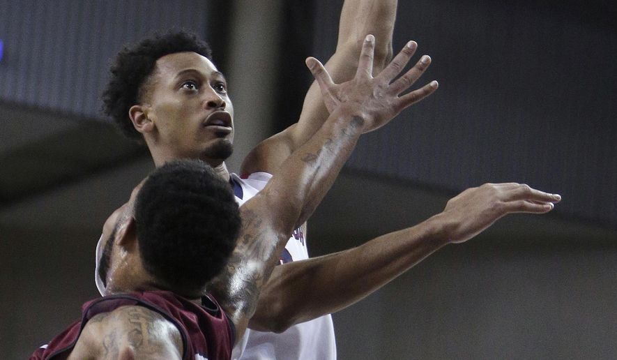 Gonzaga forward Johnathan Williams shoots while defended by Loyola Marymount forward Shamar Johnson during the first half of an NCAA college basketball game in Spokane, Wash., Thursday, Jan. 12, 2017. (AP Photo/Young Kwak)