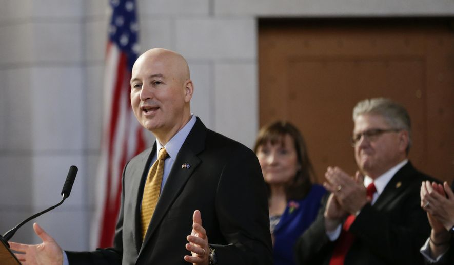 Nebraska Gov. Pete Ricketts receives applause as he delivers his State of The State address to lawmakers in Lincoln, Neb., Thursday, Jan. 12, 2017. (AP Photo/Nati Harnik)