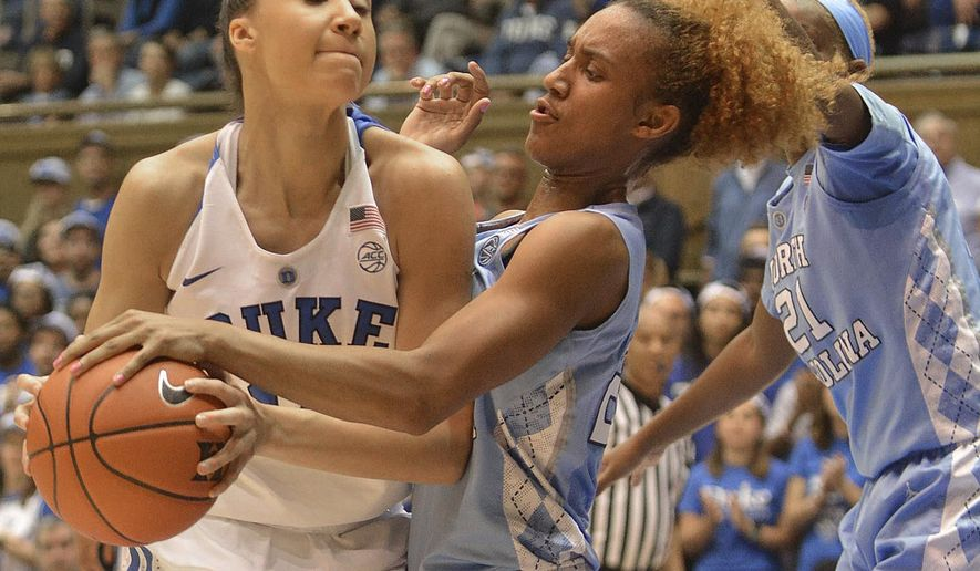 Duke's Faith Suggs tries to keep the ball from North Carolina's Paris Kea during an NCAA college basketball game Thursday, Jan. 12, 2017, in Durham, N.C. (Bernard Thomas/The Herald-Sun via AP)