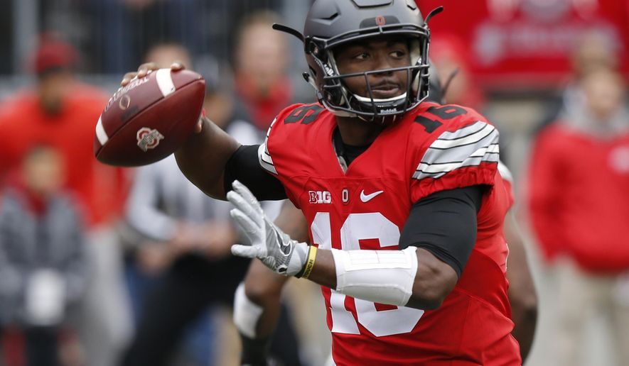 FILE - In this Nov. 26, 2016, file photo, Ohio State quarterback J.T. Barrett drops back to pass against Michigan during the first half of an NCAA college football game, in Columbus, Ohio. Underclassmen declaring for the NFL draft, some expected and some not, will change the face of the Ohio State offense whose big-play ability stalled despite veteran quarterback J.T. Barrett, a 1,000-yard rusher in Mike Weber and dynamic hybrid back Curtis Samuel. (AP Photo/Jay LaPrete, File)