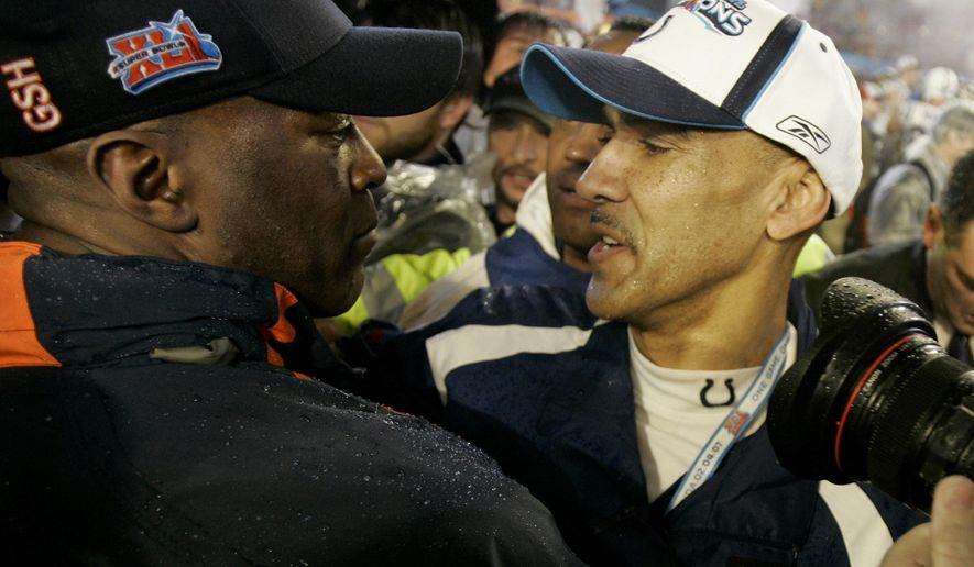 FILE - In this Feb. 4, 2007, file photo, Indianapolis Colts head coach Tony Dungy, right, hugs Chicago Bears head coach Lovie Smith at the end of the Super Bowl XLI football game at Dolphin Stadium in Miami. NFL coaching trees are such that it's rare when any game doesn't feature someone who worked for someone. Perhaps the ultimate mentor/student matchup came in the 2007 Super Bowl: Dungy vs. Lovie Smith. (AP Photo/David Duprey, File)
