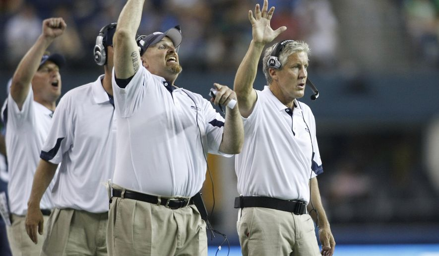 FILE - In this Aug. 14, 2010, file photo, Seattle Seahawks coaches Dan Quinn, defensive line, left, and head coach, Pete Carroll, right, gesture on the sideline during an NFL preseason game against the Tennessee Titans, in Seattle. Quinn will lead the Atlanta Falcons against Carroll's Seahawks in a divisional round playoff game  this weekend. (AP Photo/John Froschauer, File)