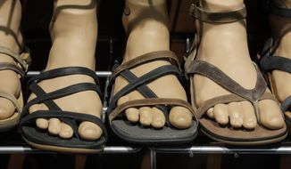 "In this Wednesday, Jan. 11, 2017, photo, Chaco sandals are shown at the Outdoor Retailer show in Salt Lake City. The majority of Chaco's sales still come from its signature ""Z-sandals,"" with crossing, adjustable straps, but the company is trying to tap into a wider market with stylish closed-toe shoes and boots that can be worn out of the water for a night out or to work. (AP Photo/Rick Bowmer)"