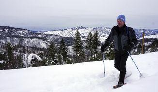In this Jan. 7, 2017 photo, Scott Williams snowshoes along a ridge on his way to Stargaze Point, north of Idaho City, Idaho. The hike offers 360-degree mountain views. (Chadd Cripe  /Idaho Statesman via AP)