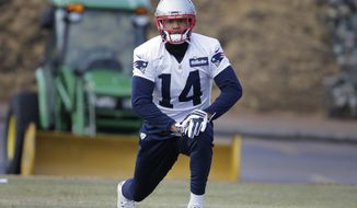 New England Patriots wide receiver Michael Floyd stretches while warming up during an NFL football practice, Thursday, Jan. 12, 2017, in Foxborough, Mass. (AP Photo/Steven Senne)