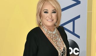 FILE - This Nov. 2, 2016 file photo shows Tanya Tucker at the 50th annual CMA Awards in Nashville, Tenn. Tucker is postponing tour dates after fracturing a vertebrae and injuring a rib during a fall while on tour. A statement from her publicist released Wednesday, Jan. 11, 2017, said Tucker was also diagnosed with bronchitis while in the hospital in Texas. The statement said she is receiving breathing treatments and physical therapy, but will not have to have surgery. (Photo by Evan Agostini/Invision/AP, File)
