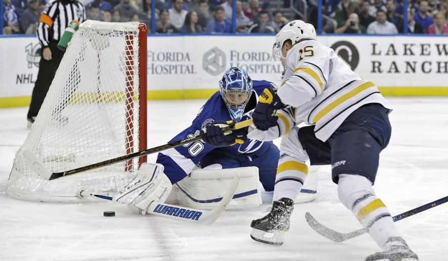 Tampa Bay Lightning goalie Ben Bishop (30) makes the save on a shot by Buffalo Sabres center Jack Eichel (15) during the first period of an NHL hockey game Thursday, Jan. 12, 2017, in Tampa, Fla.(AP Photo/Chris O'Meara)