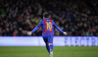 FC Barcelona's Lionel Messi reacts after scoring during a Copa del Rey, 16 round, second leg, between FC Barcelona and Athletic Bilbao at the Camp Nou in Barcelona, Spain, Wednesday, Jan. 11, 2017. (AP Photo/Manu Fernandez)