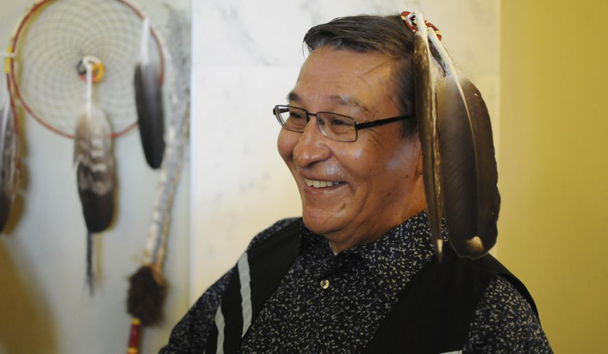 Yankton Sioux tribal Chairman Robert Flying Hawk waits to give a  State of the Tribes address to the state Legislature in Pierre, S.D., Thursday, Jan. 12, 2017.  (AP Photo/James Nord)