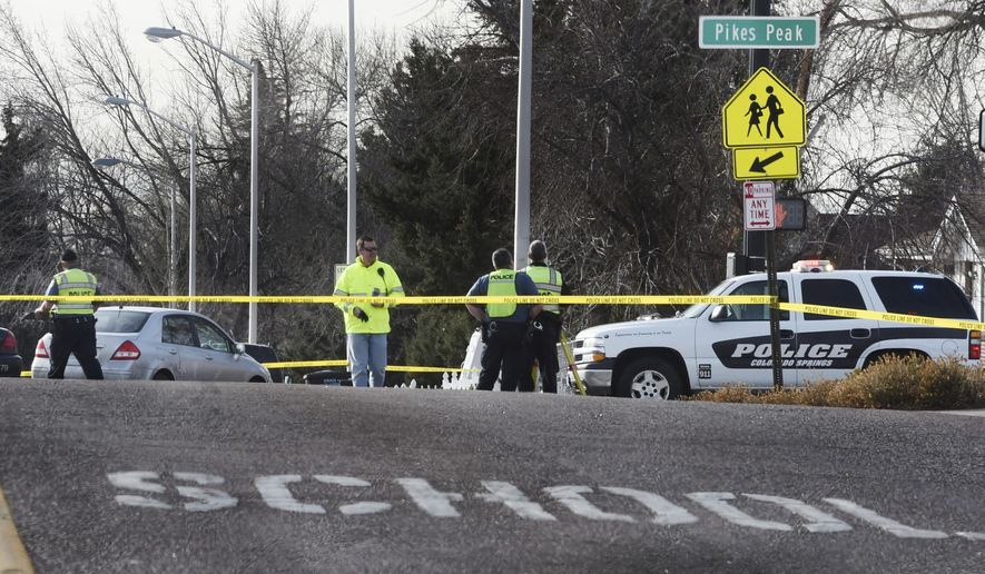 Colorado Springs police investigate the scene of an accident on Thursday, Jan. 12, 2017 in Colorado Springs, Colo.  Four children were injured after being run over on their way to school Thursday morning.  Police are still investigating what led up to the crash.  (Jerilee Bennett /The Gazette via AP)