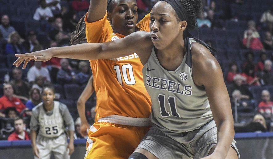 Mississippi forward Shequila Joseph (11) is defended by Tennessee guard Meme Jackson (10) during an NCAA college basketball game Thursday, Jan. 12, 2017, in Oxford, Miss. (Bruce Newman/The Oxford Eagle via AP)
