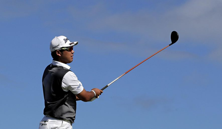 Hideki Matsuyama, of Japan, hits from the 14th tee during the final round of the Tournament of Champions golf event, Sunday, Jan. 8, 2017, at Kapalua Plantation Course in Kapalua, Hawaii. (AP Photo/Matt York)