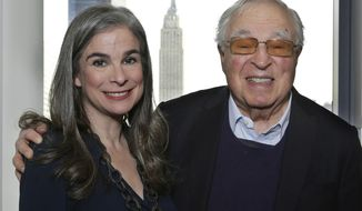 """In this Jan. 6, 2017 photo, Arthur Former, 87, right, poses with his daughter, Pauline, in New York. It's been 60 years since the publication of Frommer's legendary travel guidebook, """"Europe on $5 a Day."""" Frommer's message of authentic, bargain travel was revolutionary in its day, encouraging average people and not just the wealthy to travel. Today there are 101 Frommer's guidebooks to destinations around the world and a Frommers.com website. (AP Photo/Peter Morgan)"""