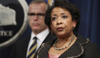 Attorney General Loretta Lynch, and FBI Deputy Director Andrew McCabe listen during a news conference at the Justice Department in Washington, Wednesday, Jan. 11, 2017, announcing criminal and civil resolutions with Volkswagen. Volkswagen pleads guilty to 3 charges, will pay $4.3 billion penalty for emissions cheating and wide-ranging cover-up. (AP Photo/Manuel Balce Ceneta)