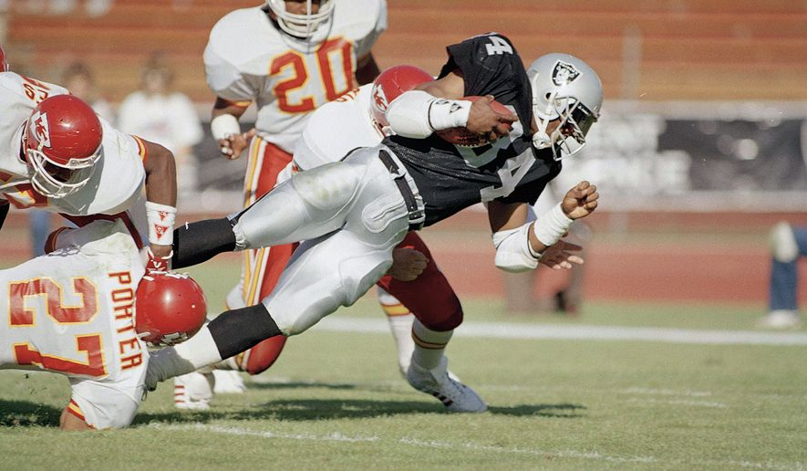 Los Angeles Raiders running back Bo Jackson goes for maximum yardage in the second quarter in game against the Kansas City Chiefs, Oct. 31, 1988, in Los Angeles.  (AP Photo/Doug Pizac)