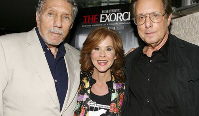 """FILE - In this Sept. 29, 2010 file photo released by Starpix, """"The Exorcist"""" author William Peter Blatty, left, joins Linda Blair, who starred in the 1973 film and William Friedkin, the film's director, at a screening of the remastered film at the Museum of Modern Art in New York. Blatty died, Thursday, Jan. 12, 2017, at a hospital in Bethesda, Md, of multiple myeloma, a form of blood cancer, according to his wife Julie. He was 89.  (Dave Allocca/Starpix via AP, File)"""