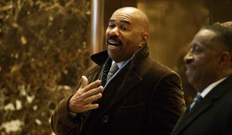 Comedian Steve Harvey arrives in the lobby of Trump Tower in New York, Friday, Jan. 13, 2017, to meet with President-elect Donald Trump. (AP Photo/Evan Vucci)