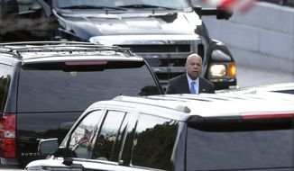 Homeland Security Secretary Jeh Johnson leaves a meeting at the White House complex in Washington, Friday, Jan. 13, 2017. (AP Photo/Susan Walsh)