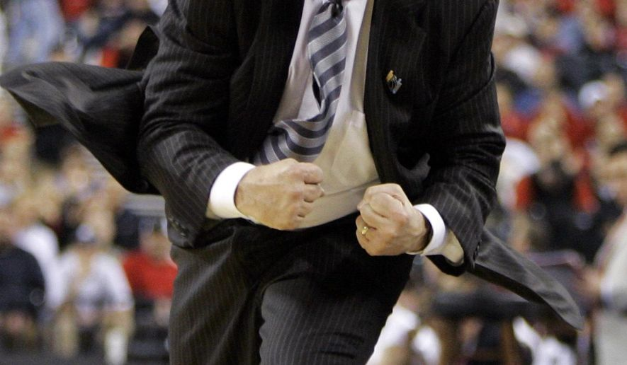 FILE - In this March 29, 2009, file photo, Michigan State coach Tom Izzo reacts after a score in the second half of the NCAA Midwest Regional men's college basketball tournament final against Louisville in Indianapolis. Izzo stands a head shorter than many of his players, yet can be the most intimidating person in the arena when he gets angry at a play or a call. (AP Photo/Darron Cummings, File)