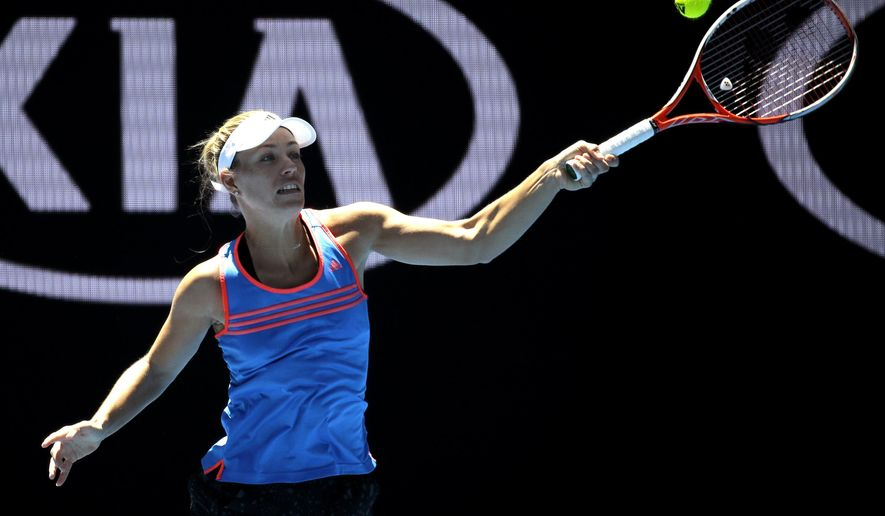 Germany's Angelique Kerber hits a forehand return during a practice session ahead of the Australian Open tennis championships in Melbourne, Australia, Thursday, Jan. 12, 2017. (AP Photo/Mark Baker)