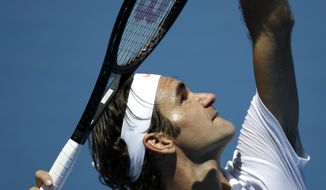 Switzerland's Roger Federer serves during a practice session ahead of the Australian Open tennis championships in Melbourne, Australia, Thursday, Jan. 12, 2017. (AP Photo/Mark Baker)